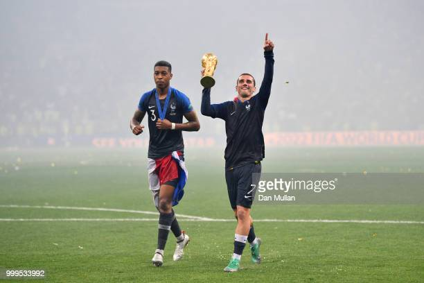 Presnel Kimpembe and Antoine Griezmann of France celebrate victory following the 2018 FIFA World Cup Final between France and Croatia at Luzhniki...
