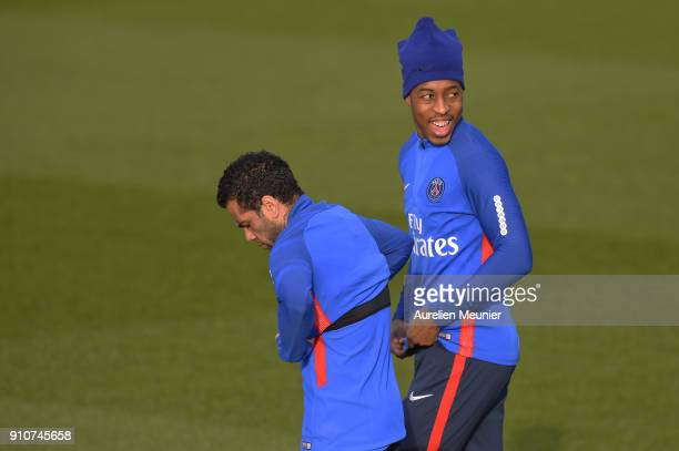 Presnel Kimpembe and Dani Alves arrives for a training session of Paris Saint Germain PSG at Camp des Loges on January 26 2018 in Paris France