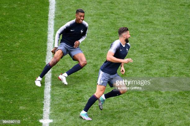 Presnel Kimpembe and Olivier Giroud of France laugh during a France Training Session at Saint Petersburg Stadium on July 9 2018 in Saint Petersburg...