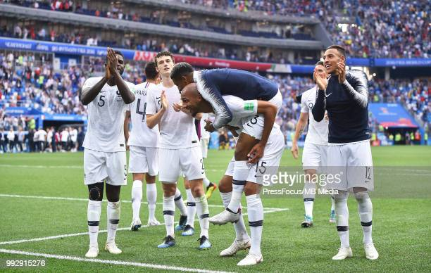 Presnel Kimpembe and Steven Nzonzi of France celebrate at full time during during the 2018 FIFA World Cup Russia Quarter Final match between Uruguay...