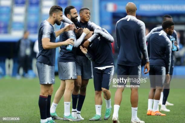 Presnel Kimpembe of France and Adil Rami of France share a joke during a training session at Nizhny Novgorod Stadium on July 5 2018 in Nizhny...