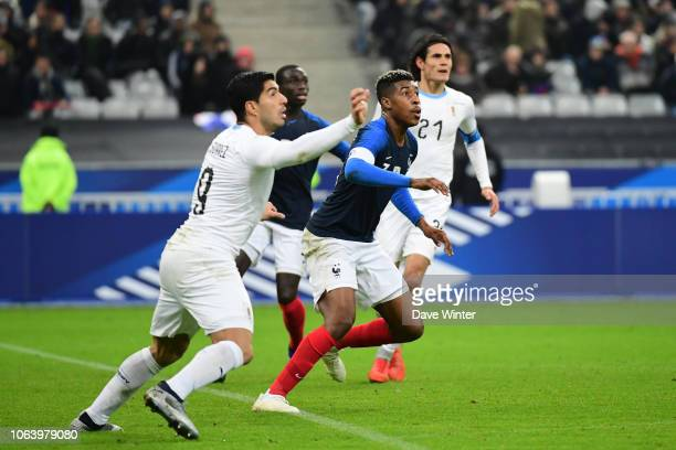 Presnel Kimpembe of France and Luis Suarez of Uruguay during the International Friendly match between France and Uruguay at Stade de France on...
