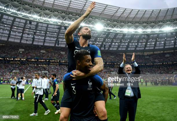 Presnel Kimpembe of France and Olivier Giroud of France celebrate following their sides victory in the 2018 FIFA World Cup Final between France and...