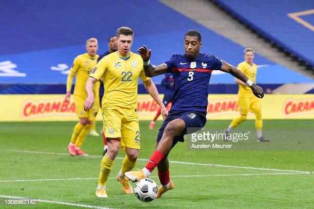 Presnel Kimpembe of France battles for possession with Mykola Matviyenko of Ukraine during the FIFA World Cup 2022 Qatar qualifying match between...