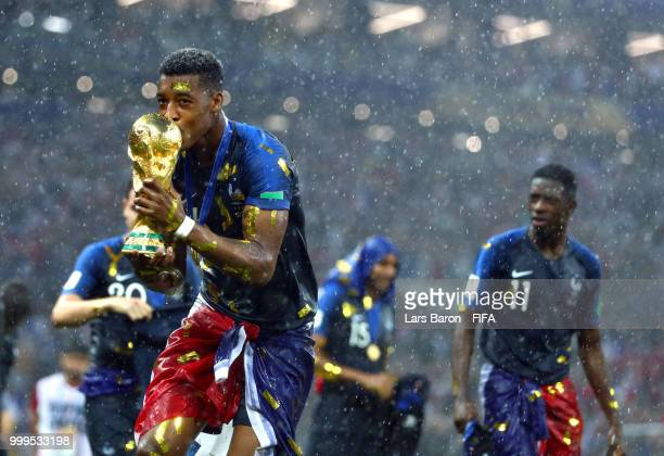 Presnel Kimpembe of France celebrates victory with the World Cup trophy following the 2018 FIFA World Cup Final between France and Croatia at...