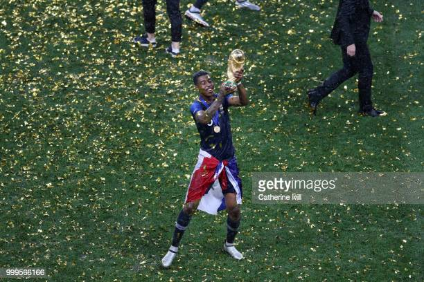 Presnel Kimpembe of France celebrates with the World Cup trophy following the 2018 FIFA World Cup Final between France and Croatia at Luzhniki...