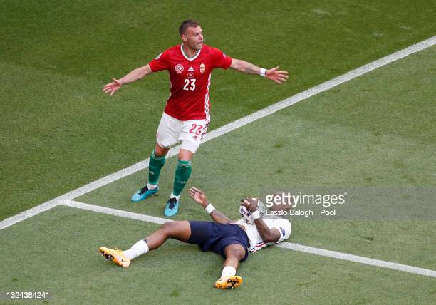 Presnel Kimpembe of France goes down after a challenge from Nemanja Nikolic of Hungary during the UEFA Euro 2020 Championship Group F match between...
