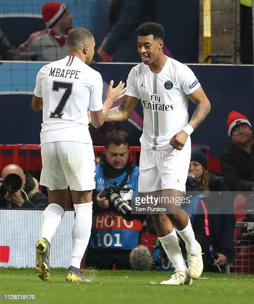 Presnel Kimpembe of Paris SaintGermain celebrates scoring their first goal during the UEFA Champions League Round of 16 First Leg match between...