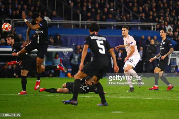 Presnel Kimpembe of Paris SaintGermain handles the ball after a shot by Diogo Dalot of Manchester Unted during the UEFA Champions League Round of 16...