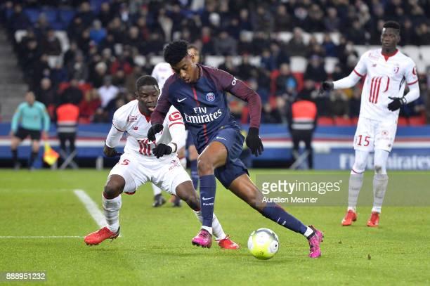 Presnel Kimpembe of Paris SaintGermain runs with the ball during the Ligue 1 match between Paris Saint Germain and Lille OSC at Parc des Princes on...