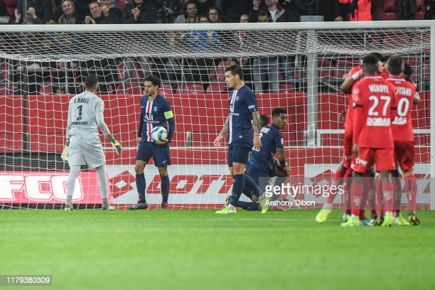 Presnel KIMPEMBE of PSG and MARQUINHOS of PSG look dejected during the Ligue 1 match between Dijon and Paris Saint Germain on November 1 2019 in...