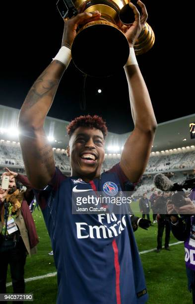 Presnel Kimpembe of PSG celebrates the victory following the French League Cup final between Paris SaintGermain and AS Monaco on March 31 2018 in...