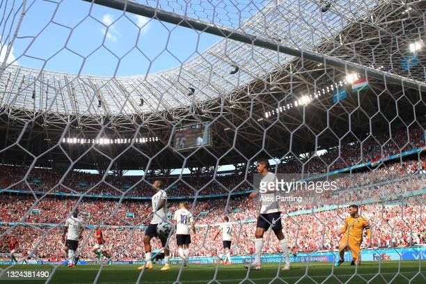 Presnel Kimpembe, Raphael Varane and Hugo Lloris of France look dejected after Hungary's first goal scored by Attila Fiola during the UEFA Euro 2020...