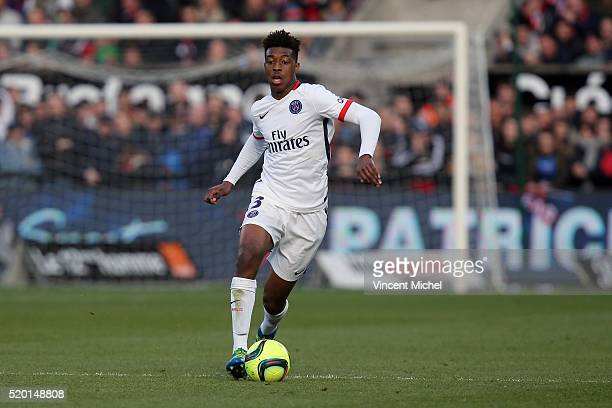 Presnel Kimpempe of Paris SaintGermain during the French League 1 match between EA Guingamp and Paris SaintGermain on April 9 2016 in Guingamp France