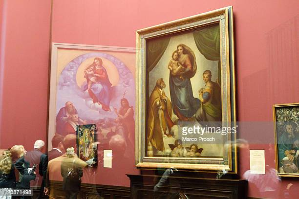 Press and visitors attend the opening of the exhibition 'Himmlischer Glanz' with Raffaelo 'Raffael' Santi's paintings 'The Sistine Madonna' and...
