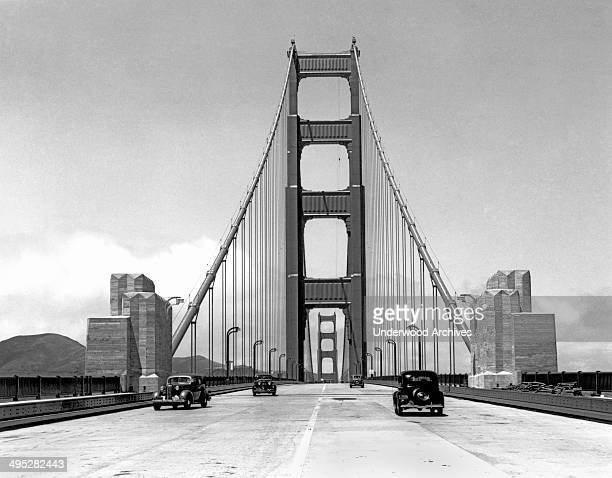 Press cars going across the about to be opened new Golden Gate Bridge San Francisco California May 24 1937