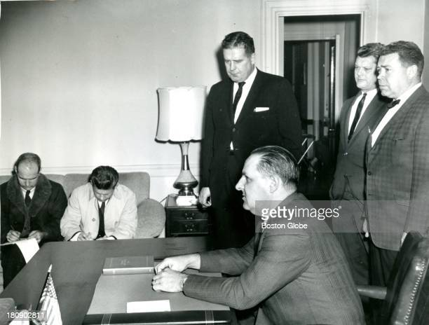 A press conference was held in the office of Boston Police Commissioner Edmund McNamara seated in foreground Jan 18 1969 He is surrounded by left to...