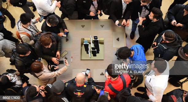 Press gather around tables with the new Samsung S8 and S8 Plus on display for the press after a news conference at David Geffen Hall in New York...