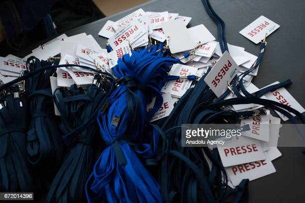 Press identification cards on the table as French Presidential Election candidate Marine Le Pen the leader of France's farright Front National...