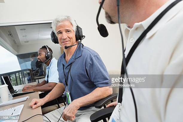 press media talking about the game at sporting event - commentator stock pictures, royalty-free photos & images