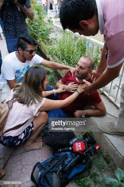 A press member gets injured on a confluence as American Pastor Andrew Craig Brunson who was charged with committing crimes including spying for the...