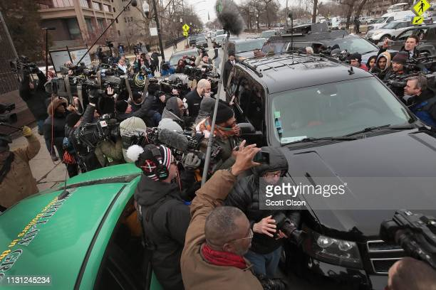 Press mob an SUV carrying Empire actor Jussie Smollett as he leaves Cook County jail after posting bond on February 21 2019 in Chicago Illinois...