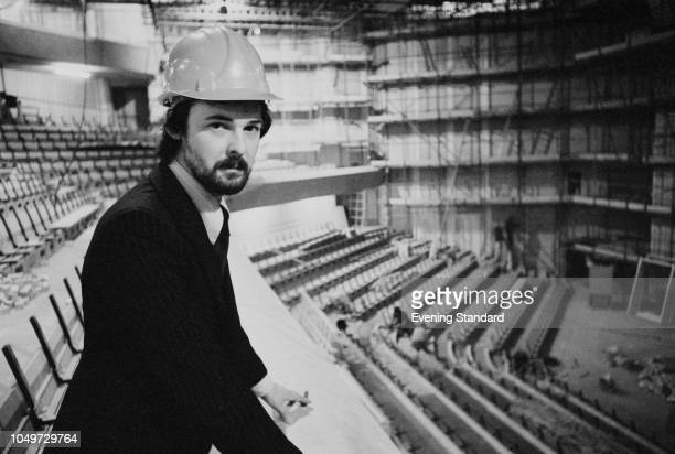 Press officer and head of marketing Angus Watson at the Barbican Centre in the concert hall while under construction London UK 30th October 1979