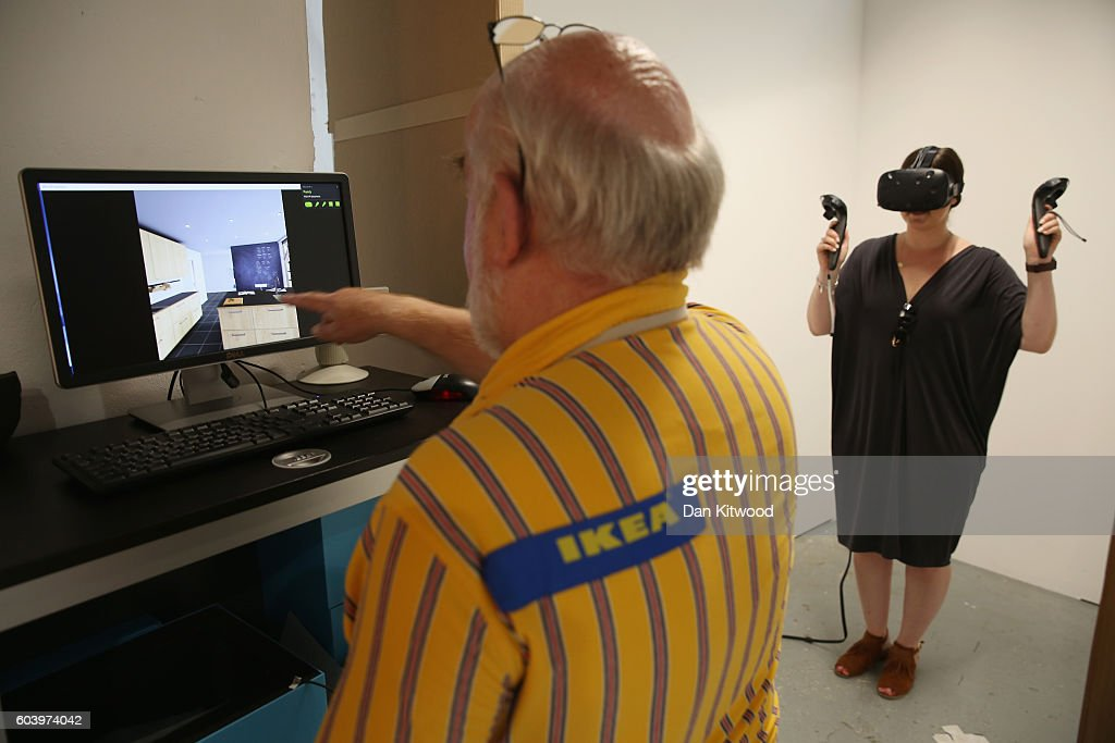 Britains first ikea pop up restaurant diy food at the dining a press officer demonstrates a virtual reality experience inside ikeas the dining club pop solutioingenieria Images