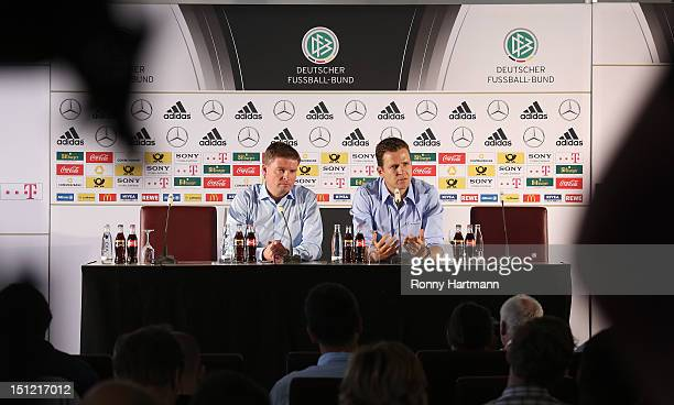 Press officer Jens Grittner and Germany's national football team manager Oliver Bierhoff attend a press conference on September 04, 2012 in...