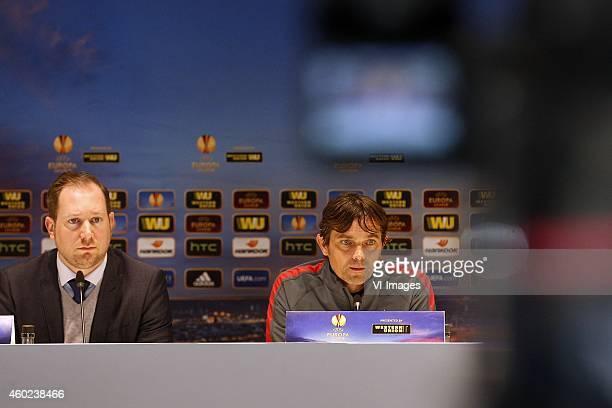Press officer Jeroen van den Berk of PSV Coach Phillip Cocu of PSV during the press conference of PSV prior to the UEFA Europa League match between...