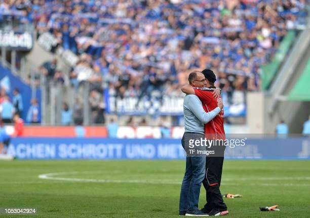 Press officer Matthias Hack of Paderborn hugs Head coach Steffen Baumgart of Paderborn after the Second Bundesliga match between 1 FC Koeln and SC...