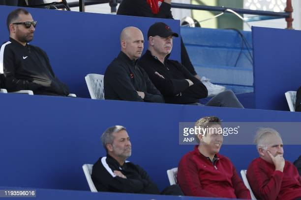 Press officer Thijs Slegers, PSV general director Toon Gerbrands during a international friendly match between PSV Eindhoven and KAS Eupen at Aspire...