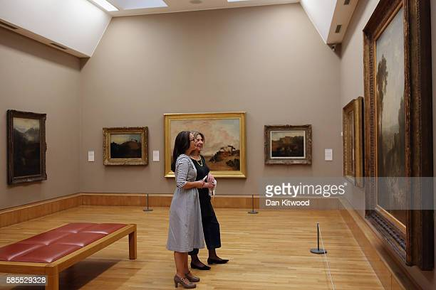 Press officers and gallery staff from Tate Britain pose in a gallery space during a photocall on August 3 2016 in London England The photocall was to...