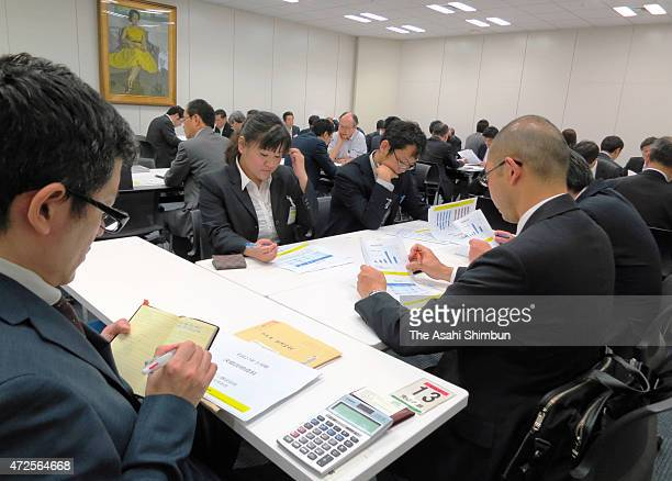 Press officers of companies and media reporters wait at a coference room at Kabuto Club press club in the Tokyo Stock Exchange on May 8 2015 in Tokyo...