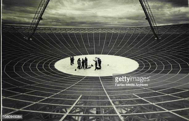 A Press party yesterday is shown the Parkes radiotelescope dish which will receive the television pictures of man's first steps on the moon July 15...