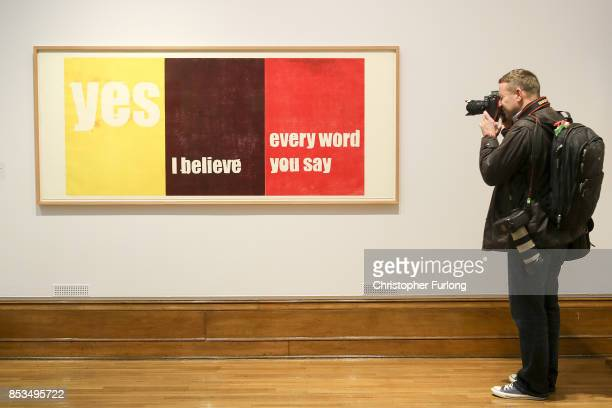A press photographer photographs Yes I believe every word you say by artist Andrea Bttner during a press preview for the 2017 Turner Prize at The...