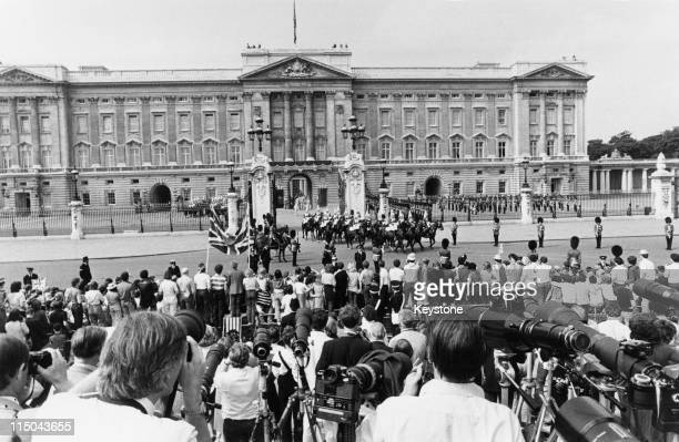 Press photographers and well wishers gathered outside Buckingham Palace at the start of the celebrations on the day of Prince Charles and Lady Diana...
