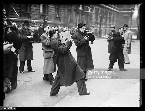 Press photographers at work 20 February 1938 A photograph of a group of press photographers in the streets of Westminster taken by Edward G Malindine...