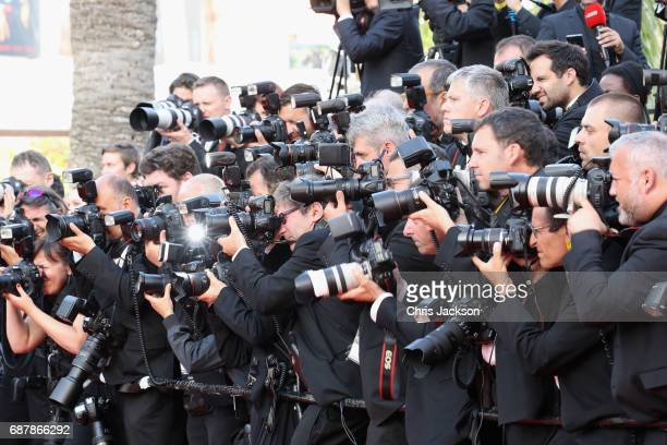 Press photographers during the 'The Beguiled' screening during the 70th annual Cannes Film Festival at Palais des Festivals on May 24 2017 in Cannes...