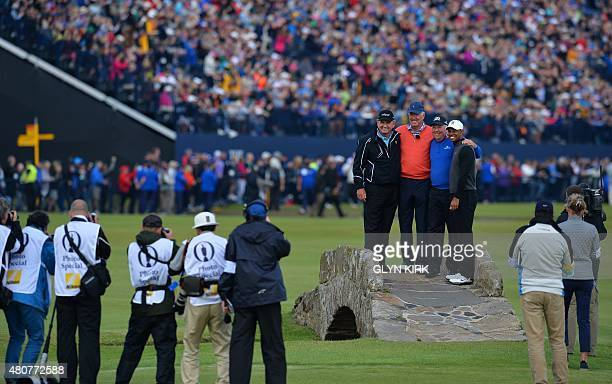 Press photographers focus on winner of The Open in 1994 Zimbabwe's Nick Price winner of The Open in 1973 US golfer Tom Weiskopf winner of The Open in...