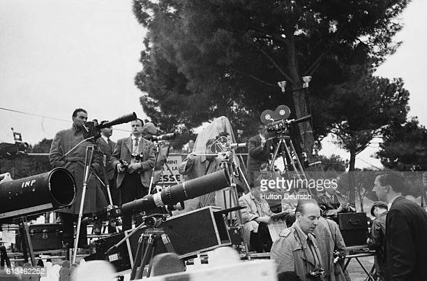 Press photographers line the route of the wedding procession on the occasion of the marriage of film star Grace Kelly to Prince Rainier III of Monaco