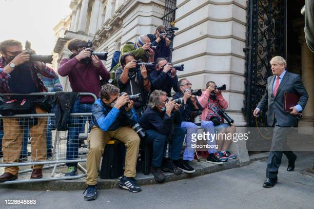Press photographers take photographs of Boris Johnson, U.K. Prime minister, as he departs following a meeting of cabinet ministers in London, U.K.,...