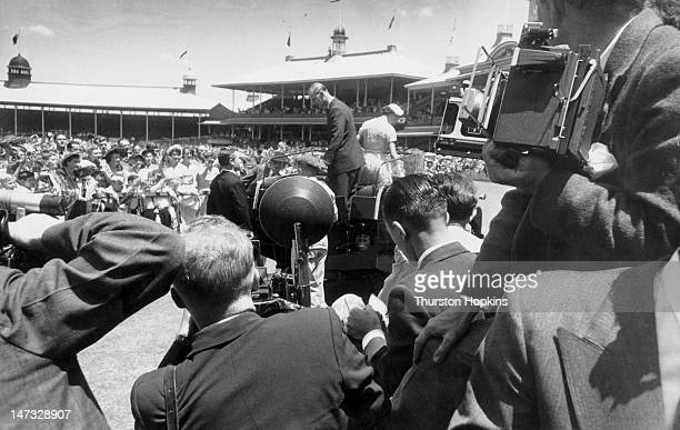 Press photographers take pictures of Queen Elizabeth II and Prince Philip during a visit by the royal couple to a children's demonstration at Sydney...