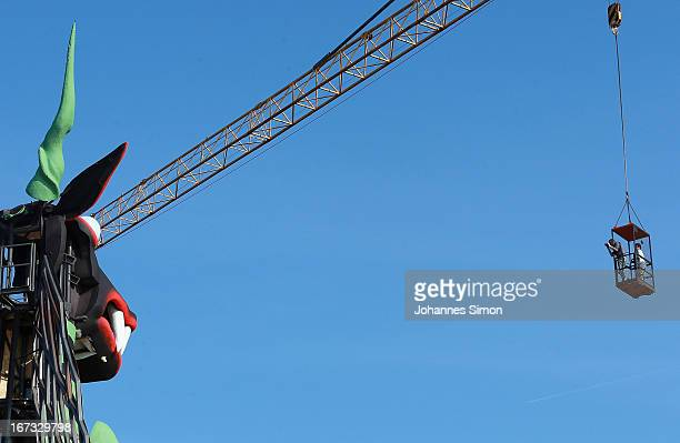 Press photographers take pictures of the 'Seebuehne' stage design during the roofing ceremony on April 24, 2013 in Bregenz, Austria. The premiere of...