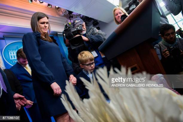 US Press Secretary Sarah Huckabee Sanders and her son Huck look on at Wishbone the turkey during a press preview before the pardoning ceremony at the...