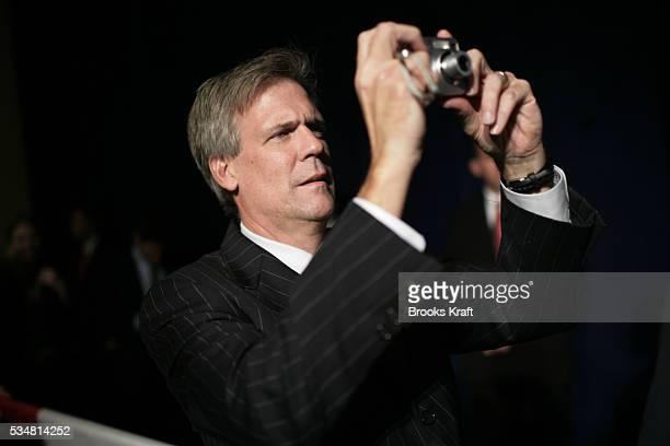 Press Secretary Tony Snow takes a photograph of President Bush at a Republican party fundraiser for Alabama's Governor Bob Riley in Birmingham,...