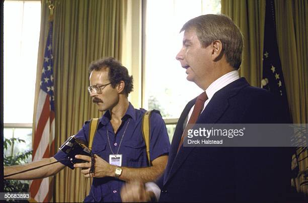 WH Press Secy Larry M Speaks talks to press during minipress conference regarding scab on nose of US Pres Ronald W Reagan after skin cancer excision