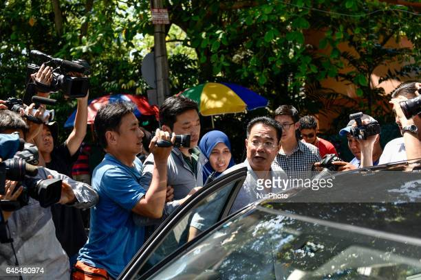 Press try to have an interview with a consul of North Korean embassy Kim Yoosung outside of the embassy on February 26 2017 in Kuala Lumpur Malaysia