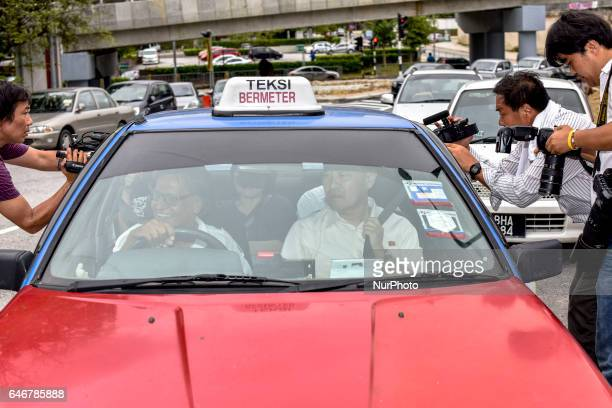 Press try to have an interview with unidentified North Korean people at outside of the North Korea embassy on March 01 2017 in Kuala Lumpur Malaysia