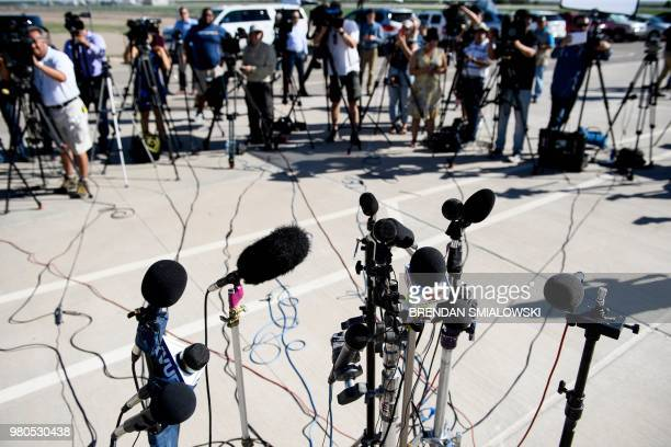 Press wait for mayors outside the Tornillo Port of Entry where minors crossing the boarder without the proper papers have been housed after being...